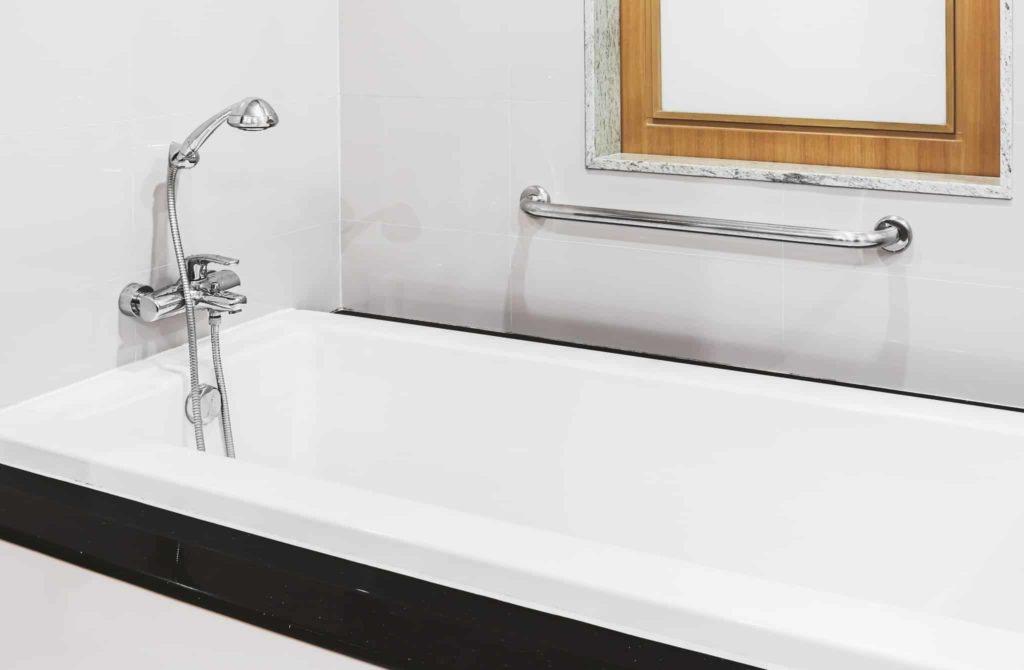 A bathtub in a hotel room bathroom