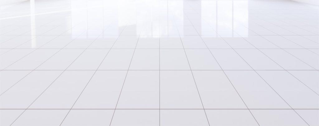 A shiny white tile floor ready for bathroom floor anti-slip coating